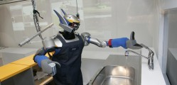 Humanoid robot HRP-2 uses a tap after washing a cup during a demonstration at Tokyo University